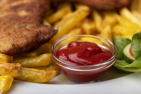wiener schnitzel with french fries on a plate  Banco de Imagens