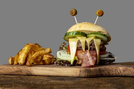 monster burger for halloween on wood