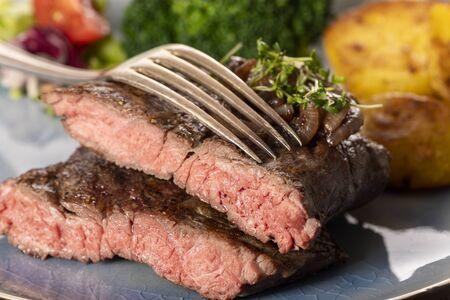 halves of a steak on a plate Stockfoto