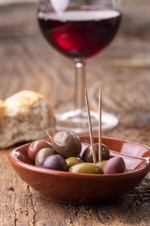 mixed olives on dark wood