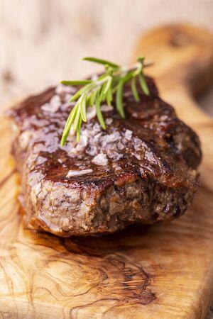 grilled juicy steak on olive wood