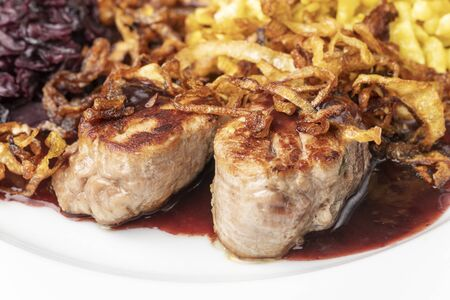 swabian pork fillets with spaetzle on a plate