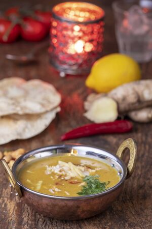 indian Mulligatawny soup in a brass bowl