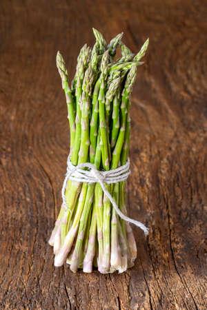 wild green asparagus on wood
