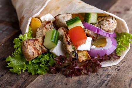 thin sandwich wrap on wood 免版税图像