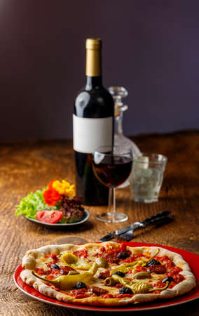 fresh pizza with red wine
