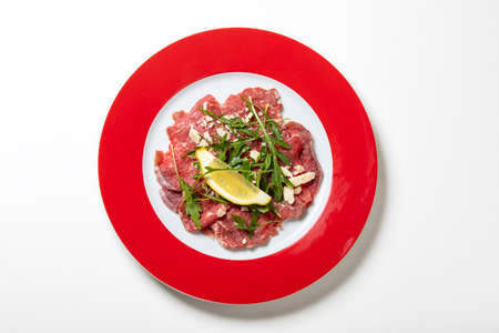 fresh carpaccio with arugula on a plate