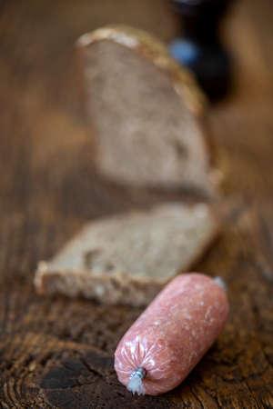 german minced meat sausage on wood