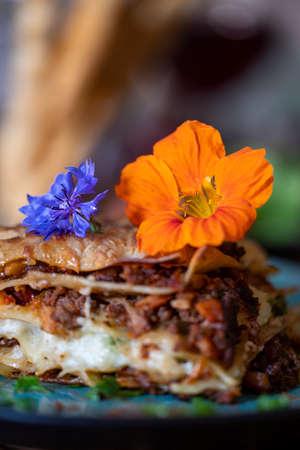 fresh lasagna on a blue plate