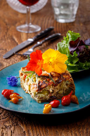 piece of french quiche with salad 免版税图像