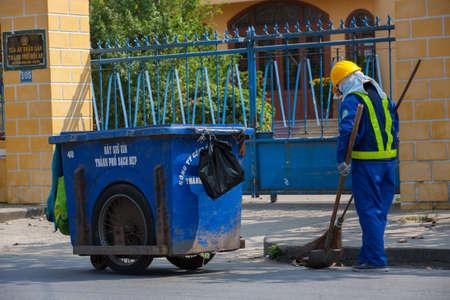 clean street: sweeper on street of hoi an, vietnam Editorial