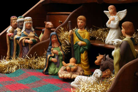 Nativity with Secretary - side view - This antique French secretaire is used as a great display for the Nativity scene. Stock Photo