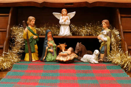 Nativity with Secretary - front view - This antique French secretaire is used as a great display for the Nativity scene. Stock Photo
