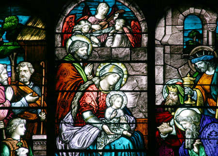 colored window: Stained Glass - Nativity Scene - Close-up on a church central window.