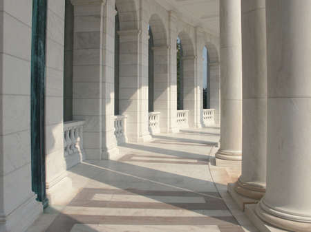 Marble Columns - a curved row of pillars joined with an elegantly carved baluster. Stock Photo