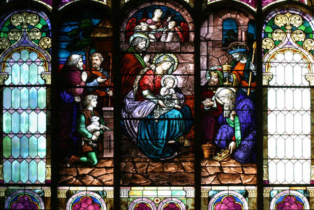 nativity: Stained Glass Church Window - Epiphany scene on a church central window. Stock Photo