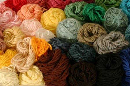 practical: Skeins of Yarn - horizontal - Practical and colorful storage of skeins of yarn being used for different knitting, crocheting, and needle-point canvas projects. Stock Photo