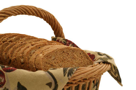 Hearty Bread Slices - close-up - Multi grain loaf in a basket.  Homemade with 100% organic ingredients: whole wheat, buckwheat, rye & barley flour, sesame seed, sunflower seed, rolled oats, molasses, rock salt, yeast & water. Standard-Bild
