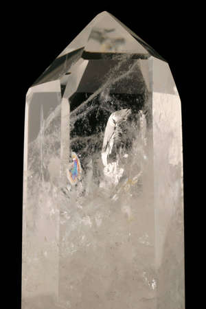 Quartz Crystal - Strongly bound structure with fluid inclusions, trigonal symmetry and crystal faces well developed.  Light passes through its geologic intricacy.  Tectosilicate. photo