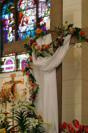 easter cross: From Birth to Resurrection - The festive decoration of a small Heartland church sanctuary during the Easter season.