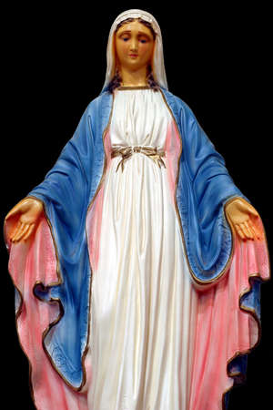 redemption: Madonna - close-up of Our Lady of the Miraculous Medal with open arms on black background.