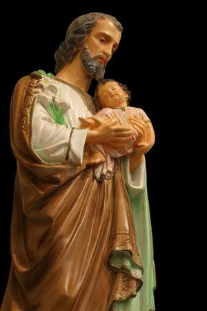 vaderlijk: Familie Patron Saint - Standbeeld van Sint Joseph die het kind Jezus.