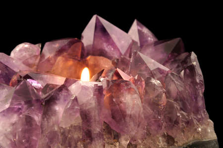 Amethyst Candle Holder - Quartz crystal used in alternative medicine to alleviate stress and anxiety. photo