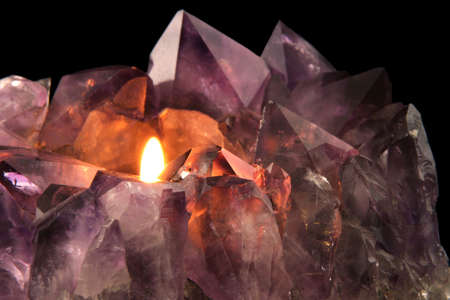 Amethyst Candlelight - Quartz crystal used in alternative medicine to alleviate stress and anxiety.