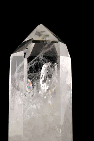 Quartz Crystal - black background - Strongly bound structure with fluid inclusions, trigonal symmetry and crystal faces well developed.  Light passes through its geologic intricacy.  Tectosilicate.