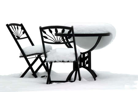 furniture: Bistro Set on White - Garden furniture after a snowstorm Stock Photo
