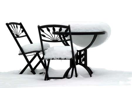 Bistro Set on White - Garden furniture after a snowstorm Banco de Imagens
