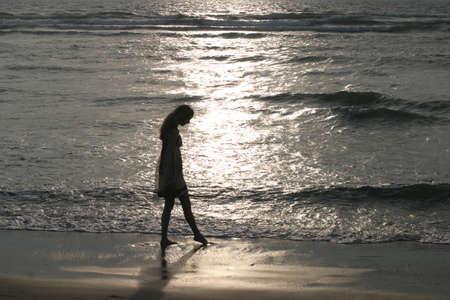 Touching the Light - Sunset at the seashore on the Atlantic coast, France.