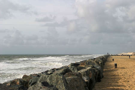 Breakwater - Massive stone structure to prevent erosion of sand dunes on the French Atlantic coast.