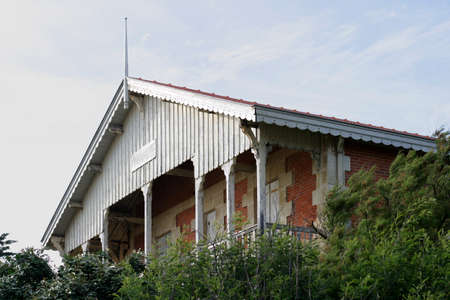 oceanfront: Abandoned Villa - The sand dune erosion leaves an oceanfront residence for the ocean. Stock Photo