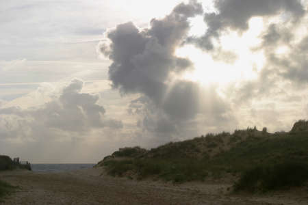 Sunset Clouds over Atlantic - Intriguing cloud formation over the sand dune.