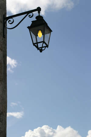 Wall-Mounted Lamppost - ornate city light on a street corner