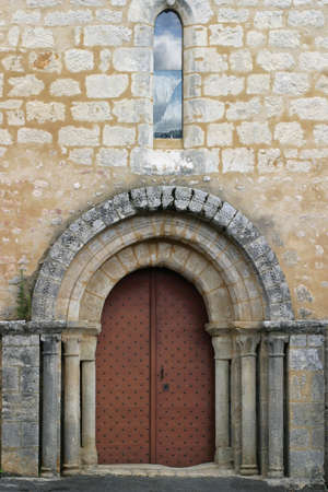 Church Door - close-up on a romanesque-style church entrance.