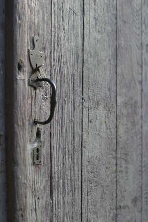 Barn Door - the sharp focus is on the wood behind the rustic door handle Stock Photo