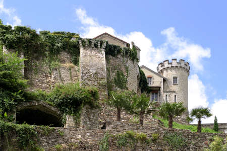 adjusted: Ramparts - remnants of a medieval fortress in Nontron, Perigord, France, adjusted for living quarters.