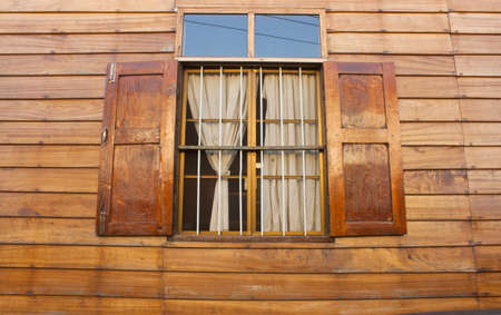 wood blinds: Thai-style, windows with open blinds in a wood.