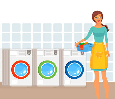 Woman in process of loading clothes into washing machine