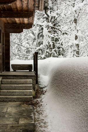 A huge snowfall covers the Italian Alps during winter season. Banco de Imagens