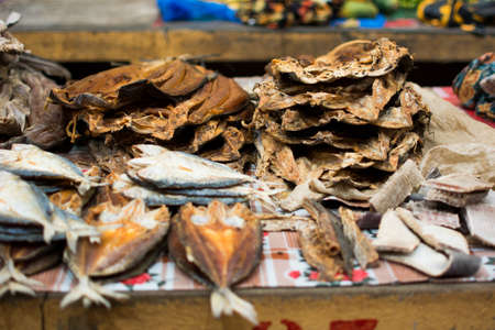 Dried fish full of flies is sold in a local market in Madagascar Banco de Imagens