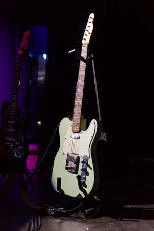 Vintage guitar on the stage of a concert