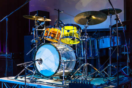 Colorful drums on the stage of a concert in a club