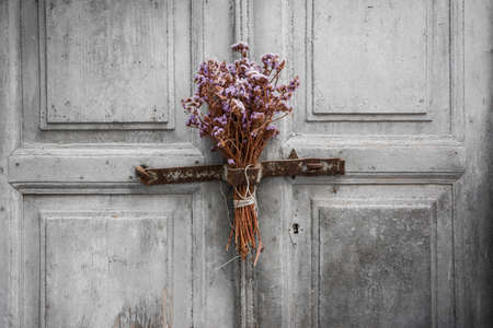 A dried bouquet hanged on an old door in the greek island of Naxos Banco de Imagens