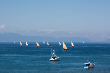 Fishermen with their old sail boats are in competition with modern boats in Madagascar Banco de Imagens