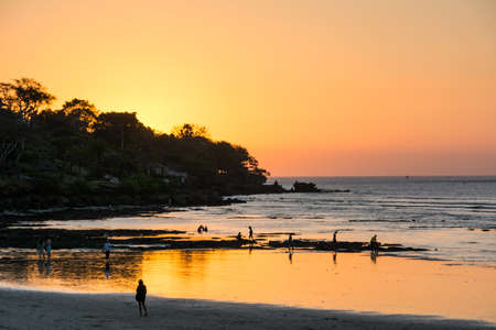 Bali is famous for its wonderful sunset you can enjoy layed on the beach. Banco de Imagens