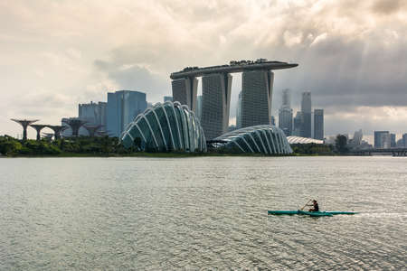 Lots of people in Singapore use their spare time to train in different kind of sports, like canoeing in the city laguna