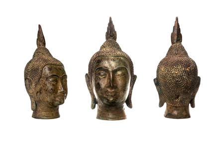 front elevation: Antique Budda head with isolated white background Stock Photo